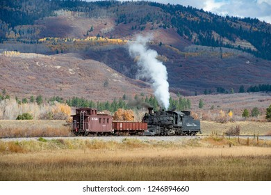 CUMBRES, NEW MEXICO, USA. 10-19-2014.  Historic loco of Cumbres &T oltec Railways with two wagons outside Cumbres station