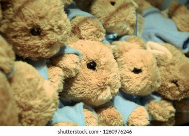 Cumbria, England - October 26 2016: close up of Peter Rabbit toys piled together with shallow depth of field. Associated with Lake District and Beatrix Potter. Illustrative editorial.