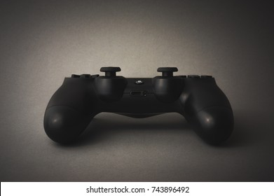 Cumbria, UK - December 21, 2016: Black and white shot of isolated black Playstation 4 game controller.