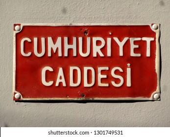 Cumhuriyet Caddesi (Republic Avenue) sign in Cunda Island, Ayvalik, Turkey.