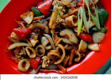 Cumi-Cumi masak lada hitam. squid cooked in black pepper, delicious and spicy
