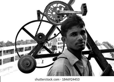 Cumilla, Bangladesh - October 10, 2016: The man sharpened the knife. Sharpening machine