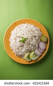Cumin rice / Indian Jeera Rice on wooden background, selective focus