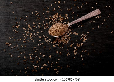 Cumin Seeds on black background