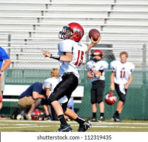 CUMMING, GA/USA - SEPTEMBER 8: Unidentified boy ready to throw a pass during a football game. A team of 7th grade boys September 8, 2012 in Cumming GA. The Wildcats  vs The Mustangs.