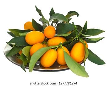 Cumquats, kumquats in bowl, orange fruits and green leaves isolated on white background.