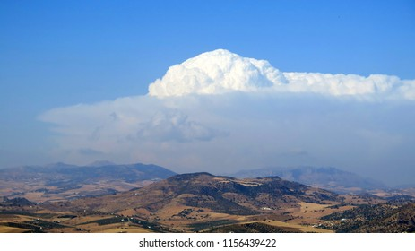 cumulonimbus cloud building over Andalusian valley, Spain