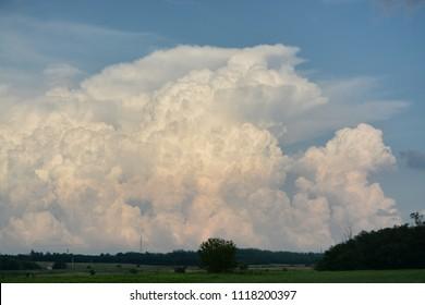 Cumulonimbus explosion on blue sky
