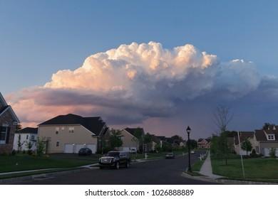 Cumulonimbus Storm Cloud Over Suburban Neighborhood in Late Evening