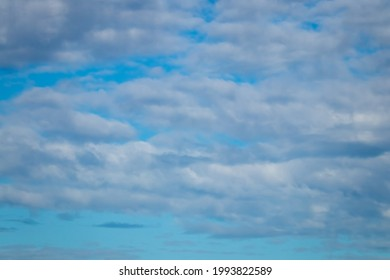 Cumulous and alto-cumulous cloud formations at sunset, Pouawa Beach, Gisborne, New Zealand
