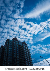 Cumulous Clouds over the Silhouette Building