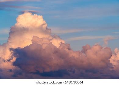 Cumulus cloud at blue sunset sky. Beautiful cloudscape at heaven as weathe ror nature background.