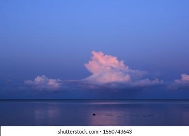Cumulus cloud over Lake Vanern. Sunset scene seen from Vita Sannar, Mellerud.