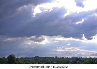 cumulus clouds above the horizon after a thunderstorm with sunspots