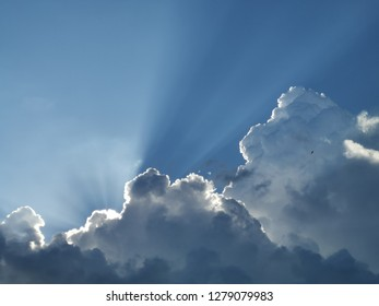 Cumulus clouds with sun rays. Background and wallpaper usage