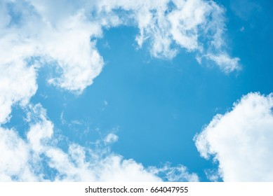 Cumulus humilis clouds in the blue sky, view from below