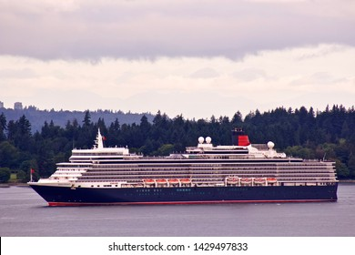 Cunard cruise ship Queen Elizabeth sails into Vancouver.  Vancouver, BC/Canada/June 20th 2019