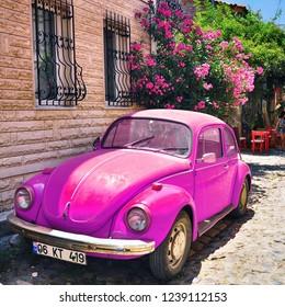 Cunda, Ayvalik / Turkey - August 14 2016 : Pink beetle in the street