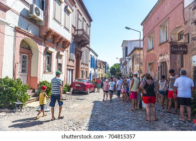 CUNDA ISLAND, BALIKESIR, TURKEY - AUGUST 22, 2017: Tourists visiting in Cunda Island. Ayvalik, Balikesir, Turkey.
