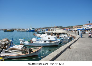 CUNDA ISLAND, BALIKESIR, TURKEY - SEPTEMBER 15, 2017: Fishing boats views on Cunda Island pier. Cunda Island a typical Aegean resort town. Cunda Island off the coast of Ayvalik, Balikesir Province.