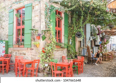 CUNDA ISLAND, BALIKESIR, TURKEY - SEPTEMBER 15, 2017: A street cafe in old touristic town Cunda Alibey Island, Ayvalik. It is a small island in the northwestern Aegean Sea off the coast of Ayvalik