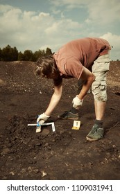 Cuneiform writing of Akkad Empire in brown clay found on summer terrain excavations