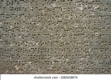 Cuneiform writing system of the ancient Sumerian or Assyrian civilization
