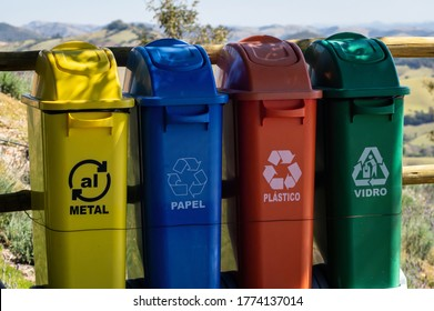 CUNHA, SAO PAULO / BRAZIL - AUG 16, 2019: Plastic waste containers used to segregate metals, papers, plastic and glass materials for recycling at the fencing of the viewing spot of O Lavandario farm.