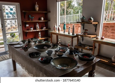 CUNHA, SAO PAULO, BRAZIL - AUG 19, 2019: Interior of the small art studio of Gaia - Ceramic Art displaying ceramic products for sale. Shop located at Alcides Barbeta street, on Cunha outskirts.