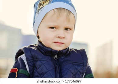 cunning funny toddler boy outdoors