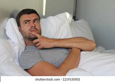 Cunning male plotting a revenge in bed