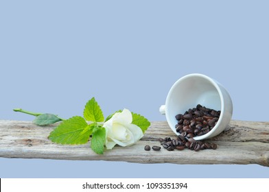 Cuo of Coffee and coffeebeans on a wooden board