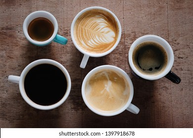cup of americano, espresso, flat white, latte, and black coffee on wooden table background