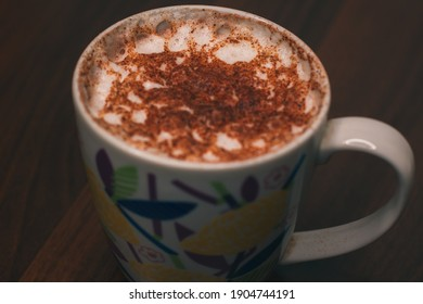 A cup of aromatic coffee or cocoa with cinnamon top view. Morning coffee. Large ceramic cup