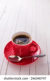 Cup of aromatic coffee on  wooden background. Selective focus.