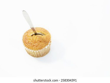 Cup of banana cake with spoon on top