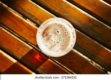 Cup of beer in garden restaurant