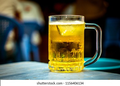 a cup of beer with ice. Vietnam is one of the biggest beer consumers in Asia drinking 3.8 billion liters a year in 2016, according to Ministry of Industry and Trade.