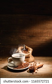 A cup of black coffee or americano with roasted coffee bean in bag, good coffee for health is black coffee without sugar and milk