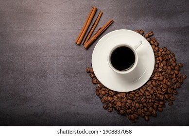 Cup of Black coffee with beans and cinnamon sticks