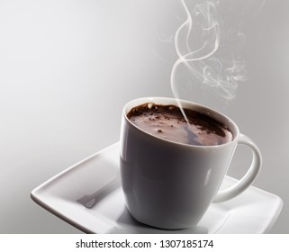 Cup of black coffee and cake on dark background