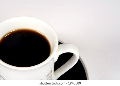 Cup of black coffee on saucer