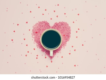 Cup of black coffee and pink hearts on pink background. St valentine's day concept, woman' s day. top view, flat lay.