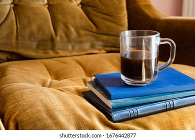A Cup Black Coffee Three Books On Yellow Sofa  Vacations Time Reading Books
