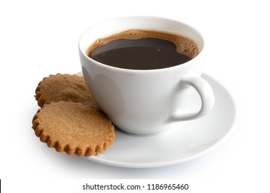 A cup of black coffee with two gingerbread biscuits isolated on white. White ceramic cup and saucer.