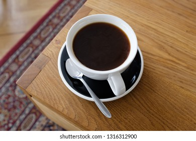 Cup of black cofffee on wood table, morning coffee.