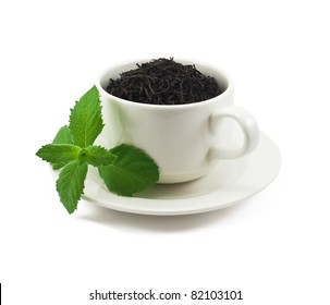 Cup of black tea with mint leaf