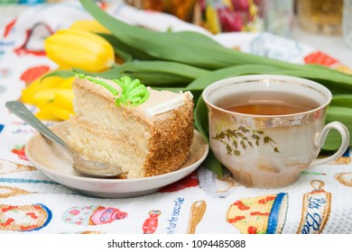 Cup of black tea, yellow tulips, tasty biscuit cake, breakfast for lovely wife, girlfriend, mother.