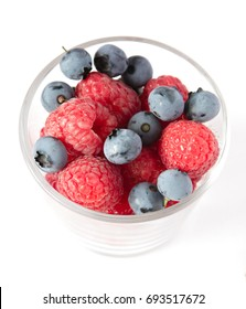 Cup with blueberries and raspberries isolated on a white background. Healthy berry bowl. Food background. Fresh yummy snacks. Healthy diet