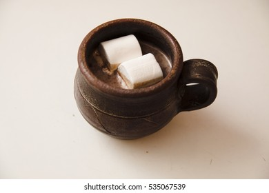 A cup of cacao with marshmallow
